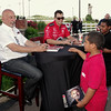 Bobby and Graham Rahal chat with Khiry Woods and Jaylin Barnes on Tuesday evening during an autograph session presented by Budweiser at Hoosier Park.