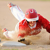 Don Knight | The Herald Bulletin<br /> Frankton's Travis McGuire dives back to first as the Eagles hosted Muncie Burris for the sectional semifinal on Thursday.