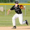 Don Knight | The Herald Bulletin<br /> Lapel short stop Satchell Wilson fields the ball as the Bulldogs faced Wapahani in the first round of the sectional at Frankton on Wednesday.