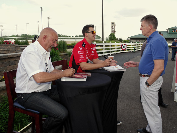 Madison Circuit Court Magistrate Kevin Eads visits with Bobby and Graham Rahal Tuesday evening at an autograph session presented by Budweiser at Hoosier Park.