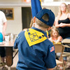 Danielle Grady | for The Herald Bulletin<br /> A wolf cub holds Cub Scout Pack 220Õs pack flag during a flag ceremony on April 26. Gene McMahon revived Pack 220 twice during his time volunteering for Anderson cub scout packs and boy scout troupes.