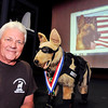 John P. Cleary | The Herald Bulletin<br /> John Meeks of the United States War Dog Association gives a presentation to Anderson High School students Thursday about the history of  K-9s in warfare.  AHS's NJROTC hosted the event.