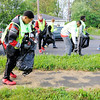 Don Knight | The Herald Bulletin<br /> Scott Amos, 15, picks up a can from the sidewalk as members of Anderson basketball team take part in the 31st Annual Rev. J.T. Menifee Citywide Clean-up on Saturday.