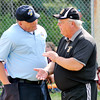 John P. Cleary | The Herald Bulletin<br /> Daleville's coach Dick Hines asks for a explanation from the umpire on the call that was made during their game against Wes-Del.