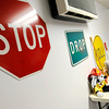 Don Knight | The Herald Bulletin<br /> Stop Drop and Roll are displayed on signs in the AFD Fire Safety House at the Anderson Public Library. AFD reopened the Fire Safety House on Thursday.