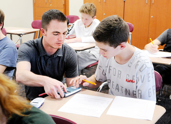 Don Knight | The Herald Bulletin<br /> Pendleton Heights Middle School math teacher Darin DeNeal answers a question for student Luke Weaver. DeNeal was chosen by the Noon Anderson Exchange Club as the secondary school Max Beigh Award winner.