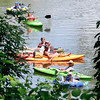 John P. Cleary | The Herald Bulletin<br /> With warm, sunny skies for Memorial Day these folks enjoyed the day boating on White River.  This fleet off water craft was seen floating through Anderson Monday afternoon.