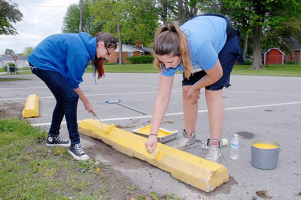 Stu Hirsch | The Herald Bulletin<br /> Students fan out across the city of Elwood to complete clean-up projects during the Elwood Schools Day of Caring on Friday.