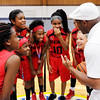 Don Knight | The Herald Bulletin<br /> Coach Courtney Dock, right, talks to his team the Lady Heat that is part of the the Anderson Township youth basketball program. From left are Tyra Ford Kayla Williams, Velynncia Williams, Ka'Neisha Tilford, Molly McCullough, Zahra Dock and Karlee Goodwin. Not pictured are Javelyn Lewis and Brooklyn King.