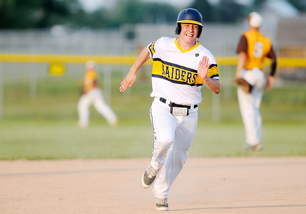 Don Knight | The Herald Bulletin Shenandoah's Tyler James rounds third headed for home as he is batted in on a double by Cody Rudy as the Raiders faced Monroe Central in the first round of the sectional at Frankton on Wednesday.