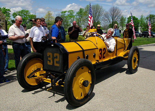 Mark Maynard | for The Herald Bulletin<br /> Corky Coker fires up his exact replica of the Marmon Wasp in which Ray Harroun won the first Indianapolis 500 in 1911 prior to the dedication of a memorial marker honoring Harroun at Anderson Memorial Park Cemetary on Sunday.