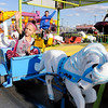 Don Knight | The Herald Bulletin<br /> From left, Zy'Aihre Logan, 4, and her sister Bailey Hendrix, 3, ride on The Pony Corral at the Little 500 Festival Fair in the Applewood Center on Wednesday. The fair continues through Sunday opening at 5 p.m. today and Friday and 3 p.m. on Saturday and Sunday. Proceeds benefit the Little 500 Foundation.