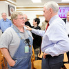 Don Knight | The Herald Bulletin<br /> Gov. Mike Pence talks to Roger Manship as he and Lt. Gov. Eric Holcomb made a campaign stop at Good's Candy Shop on Thursday.