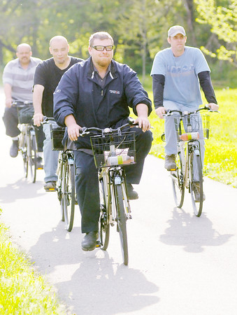 Don Knight | The Herald Bulletin<br /> Derek Miller rides a Community Bikes bike during the Mayor's Bike Ride Thursday. The bike sharing program will be housed in a livery at The Christian Center.