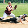 John P. Cleary | The Herald Bulletin<br /> Daleville's Krystal Watters slides into second as Wes-Del's Heather Holeman just holds on the ball for the force out in the 2nd inning of their sectional championship game.