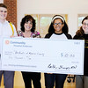 Don Knight | The Herald Bulletin<br /> Community Hospital Anderson added $10,000 to a fundraising effort by Madison County students for students affected by the Flint, Mich. water crisis. From left are Cade Grubbs from APA, Beth Tharp from Community, Debriana Love and Jaqui Schreiber both from Pendleton Heights.