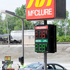 Don Knight | The Herald Bulletin<br /> Ed Cage fills up at the McClure gas station on Main Street where gas was selling for $2.15 on Tuesday. While gas prices are trending higher ahead of the holiday weekend they are still lower than they were last year.