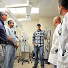 John P. Cleary | The Herald Bulletin<br /> Jake Hendrick, center, talks with members of St. Vincent Anderson Regional Hospital's trauma team in the trauma room where most of these doctors treated him in 2014 when he was severely injured. Hendrick tells Dr. Khalil Wakim, Dr. Kash, Dr, Andrew Ritchison, and Dr. Gregory Pugh how well he has recovered from his injuries since his accident. The hospital has recently received their Level 3 trauma certification.