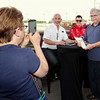 Mark Maynard | For The Herald Bulletin<br /> Laura Wilson of Alexandria snaps a picture of her husband, Mike, with Bobby and Graham Rahal during an autograph session presented by Budweiser at Hoosier Park.