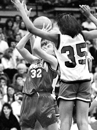 THB file photo<br /> Anderson's Sarah Armington goes up for a shot against Madison Heights in their game in the 1991 Anderson sectional tournament.