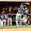 Chris Martin   for The Herald Bulletin <br /> The Raider dugout looks on as catcher Coult McWilliams catches a pop up foul Saturday against Alexandria.