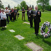 Mark Maynard | for The Herald Bulletin<br /> As Ray Harroun's granddaughter, Barbara Sherlin, looks on, Pastor John Hackney of the United Methodist Church holds a graveside service and wreath laying at the resting place of Harroun, winner of the first Indianapolis 500.