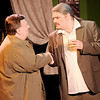 "Don Knight | The Herald Bulletin<br /> Warnock Waldgrave (Scott McFadden) introduces himself to Axel Hammond (Sean Christian Smith) during a dinner party in Mainstage Theatre's production of ""The Nerd."""