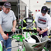 Mark Maynard | for The Herald Bulletin<br /> Greg Powell of Indianapolis and his son, Garritt of Danville, who are both drivers, use a laser guaging system to set the front spindles on one of their karts.