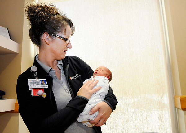 Don Knight | The Herald Bulletin<br /> Elizabeth Arnett, lactation services coordinator, holds newborn Findley Smith at Community Hospital in Anderson on Friday.