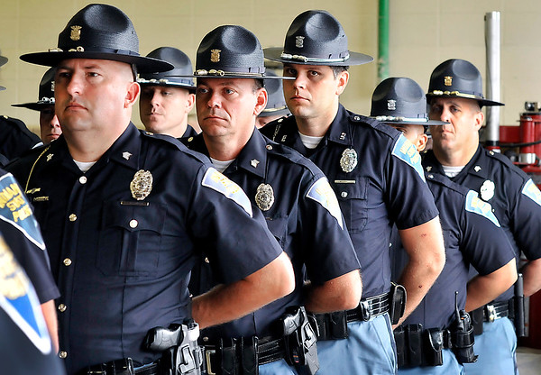 John P. Cleary |  The Herald Bulletin<br /> Indiana State Police troopers listen to the roll call of those who have died in the line of duty during the the annual memorial service Wednesday.