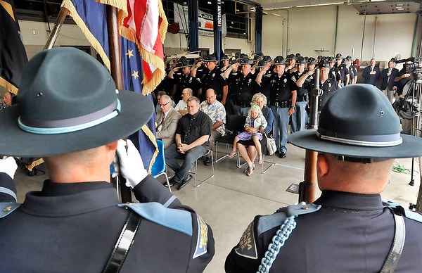 John P. Cleary |  The Herald Bulletin<br /> The Indiana State Police troopers of  Pendleton District 51 salute their fallen comrades during the playing of Taps at the annual memorial service Wednesday at the post. Every May each district holds a service to perpetuate the memory of those who have died in the line of duty.