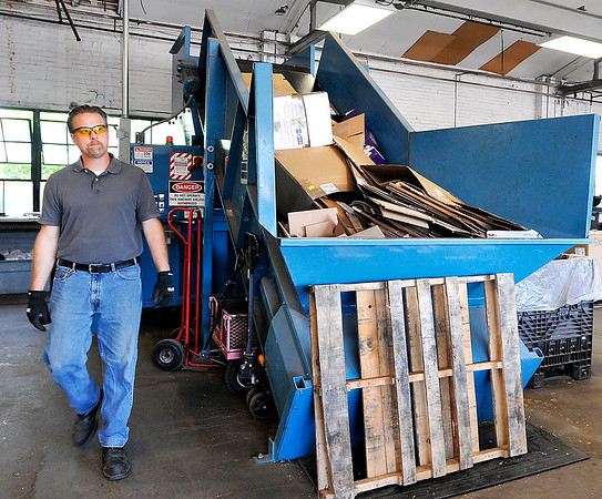 John P. Cleary |  The Herald Bulletin<br /> Madison County Recycling Center director Jim Eichhorn checks the compactor as he runs a load of cardboard through the machine at the recycling center Tuesday.