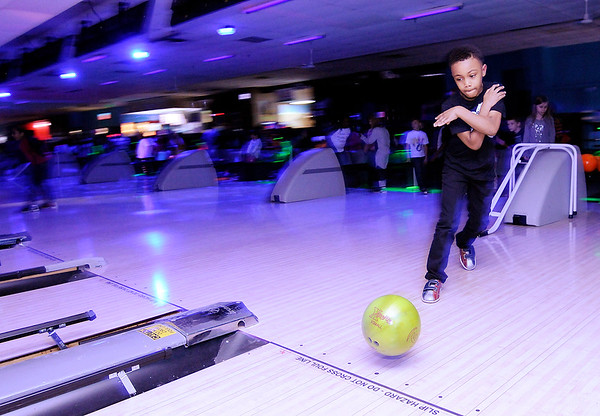 Don Knight   The Herald Bulletin<br /> Demari Wills releases the ball down the lane as Anderson Elementary students went bowling at Championship Lanes on Friday.