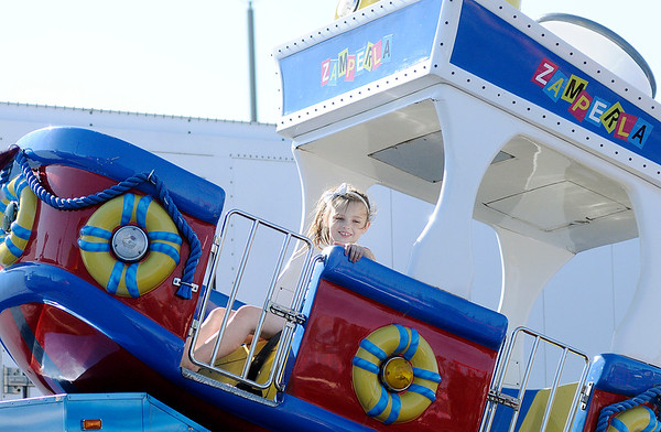 Don Knight | The Herald Bulletin<br /> Kylie Martin, 9, rides the Zamperla at the Little 500 Festival Fair at Applewood Center on Friday. The fair runs through the 22nd and benefits the Little 500 Foundation.
