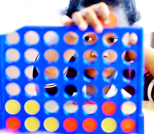 John P. Cleary |  The Herald Bulletin<br /> Six-year old Jimir Sandford contemplate her next move as she plays Connect4<br /> at the Girls & Boys Club after school Tuesday.