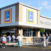 Don Knight | The Herald Bulletin<br /> Shoppers line up for the reopening of ALDI on Thursday after a five week remodel.