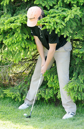 Don Knight   The Herald Bulletin<br /> Lapel's Logan McAtee faces a tough lie next to a tree as he chips onto the second green at Grandview during the County golf tournament on Monday.