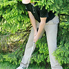 Don Knight | The Herald Bulletin<br /> Lapel's Logan McAtee faces a tough lie next to a tree as he chips onto the second green at Grandview during the County golf tournament on Monday.