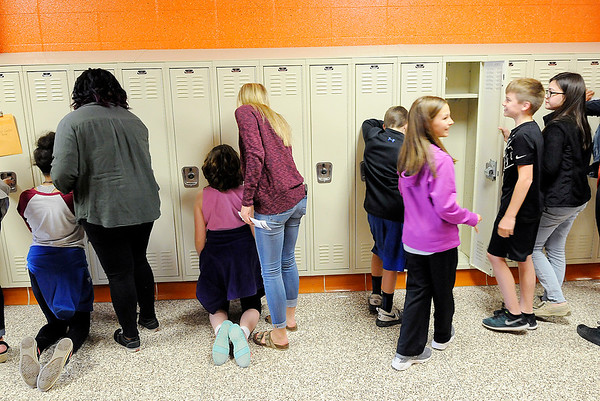 Don Knight   The Herald Bulletin<br /> Sixth graders practicing opening lockers during their tour of the Madison-Grant Junior High on Friday.