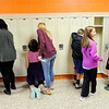 Don Knight | The Herald Bulletin<br /> Sixth graders practicing opening lockers during their tour of the Madison-Grant Junior High on Friday.