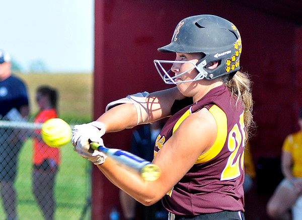 John P. Cleary |  The Herald Bulletin<br /> Alexandria's Mackenzie McCarty turns on this pitch as she bats against Monroe Central in the opening game of the Frankton 2A softball sectional. Monday. McCarty hit a homerun for her efforts.