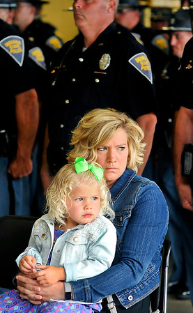 John P. Cleary |  The Herald Bulletin<br /> Shae Davis, of Parker City, and her daughter Scarlet Davis, 3, reflect together during the annual Indiana State Police Pendleton District Memorial Service Thursday that pays tribute to those who have died in the line of duty.<br /> Davis is the wife of  Trooper Ryan Davis and came to the memorial service to pay her respects.