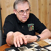 John P. Cleary |  The Herald Bulletin<br /> Greg Frolke goes over photos and letters belonging to his father from WWII after being found in a storage locker by Richard Petty. Petty tracked Frolke down to return the items to the family.