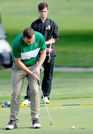 Don Knight   The Herald Bulletin<br /> Anderson's Wil Lashbrook putts on the first green during the County golf tournament at Grandview on Monday.