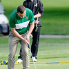 Don Knight | The Herald Bulletin<br /> Anderson's Wil Lashbrook putts on the first green during the County golf tournament at Grandview on Monday.
