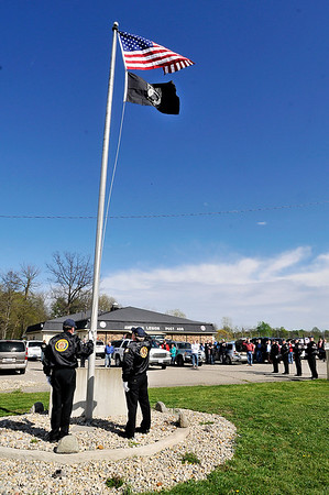 John P. Cleary |  The Herald Bulletin<br /> The American Legion Honor Guard salutes the new American flag after raising it over the Chesterfield American Legion Post 408 last Saturday during a reopening celebration for the post.