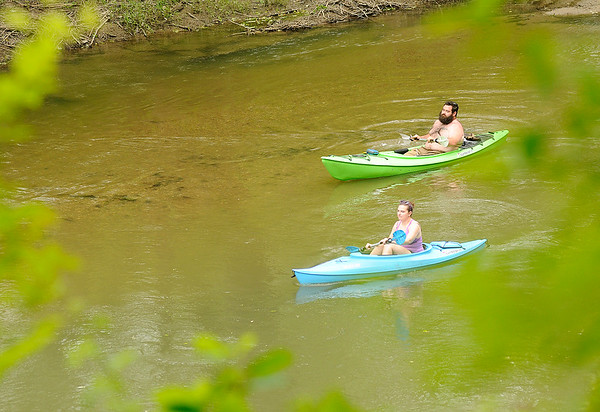 Don Knight   The Herald Bulletin<br /> Kayakers paddle down the White River past Mounds State Park on Wednesday.