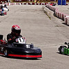 Mark Maynard | for The Herald Bulletin<br /> Karts head down the long back-stretch into the left-hand hairpin turn leading to the front straightaway.