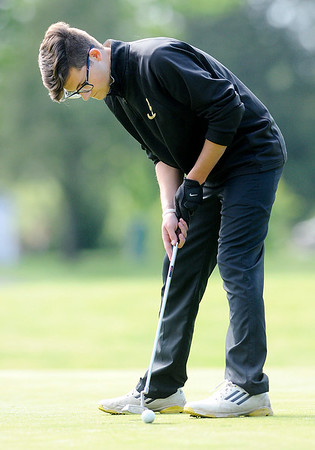 Don Knight | The Herald Bulletin<br /> Madison-Grant's Cole Bramel putts on the ninth green during the County golf tournament at Grandview on Monday.