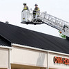 Don Knight | The Herald Bulletin<br /> AFD responds to the report of a fire on the roof of a vacant storefront next to the China House on Scatterfield Road on Wednesday.